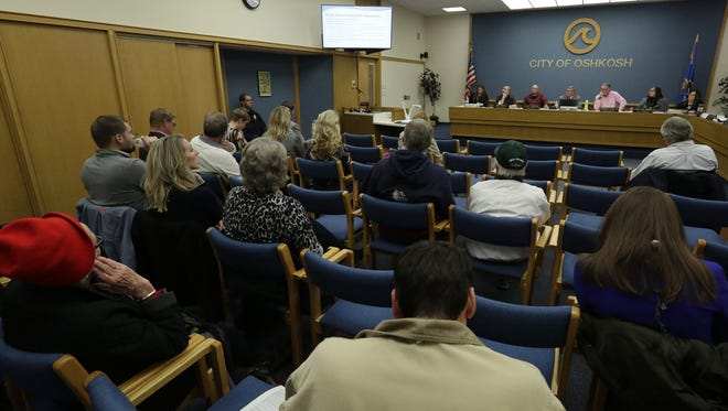 The Oshkosh Common Council approves a proposal Wednesday, Nov. 8, 2017, to try to keep Oshkosh Corp. headquarters in the city.