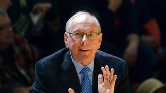 Syracuse coach Jim Boeheim applauds his team during a Jan. 3 game against Virginia Tech in Blacksburg, Va.