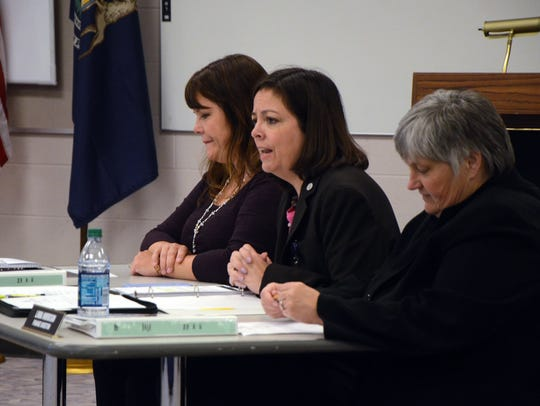 Battle Creek City Manager Rebecca Fleury, center, explains