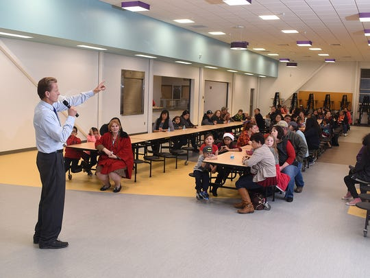 Principal Steve Carlson addresses parents and children at the new Judy Nelson Elementary School on Wednesday in Kirtland.