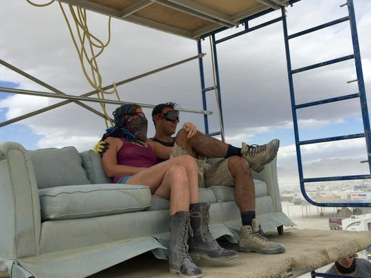 A couple relax at Altitude Lounge during preparations