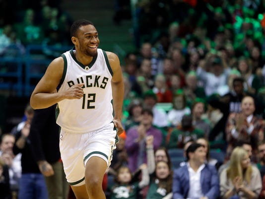 FILE - In this Dec. 23, 2016, file photo, Milwaukee Bucks' Jabari Parker smiles during the first half of an NBA basketball game against the Washington Wizards in Milwaukee. Parker hopes he can become a better player when he returns from his second left ACL injury in three seasons. (AP Photo/Aaron Gash, File)