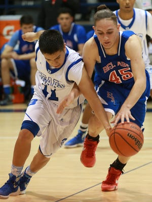 Bowie's Josh Hidalgo, left, attempts to steal the ball from Bel Air's Isaiah Aguilera during the fourth quarter Tuesday.