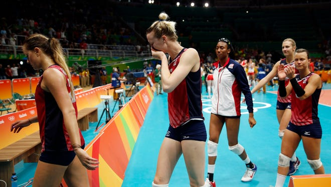 Members of the United States team walk off the court after losing a women's semifinal volleyball match against Serbia at the 2016 Summer Olympics in Rio de Janeiro, Brazil, Thursday, Aug. 18, 2016.