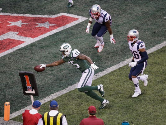 New York Jets wide receiver Brandon Marshall (15) runs past New England Patriots' Logan Ryan (26) and Jordan Richards (37) for a touchdown during the first half of an NFL football game Sunday, Dec. 27, 2015, in East Rutherford, N.J. (AP Photo/Peter Morgan)