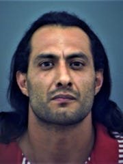 Michael Huerta, 34, was arrested in the fatal stabbing of a man.