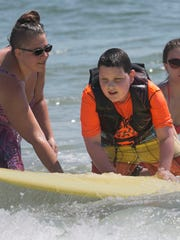 Autistic children learn how to surf in Seaside Park.