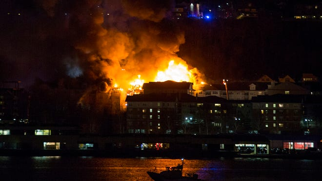 Smoke billows from a multi-alarm fire burning in Edgewater, N.J., as seen in New York from across the Hudson River, Wednesday, Jan. 21, 2015. No injuries have been reported in the blaze that broke out around 5 p.m. on Russell Avenue in Edgewater, N.J. Authorities say it appears that everyone in the building was able to get out safely. (AP Photo/Craig Ruttle)