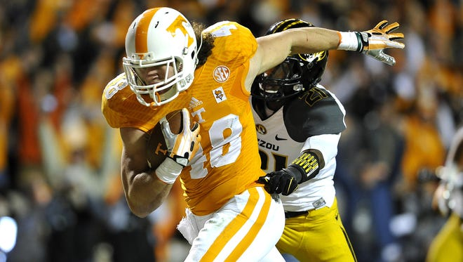 Tennessee tight end Alex Ellis (48) runs for a touchdown in the first half as the University of Tennessee plays Missouri at Neyland Stadium Saturday Nov. 22, 2014, in Knoxville, TN.