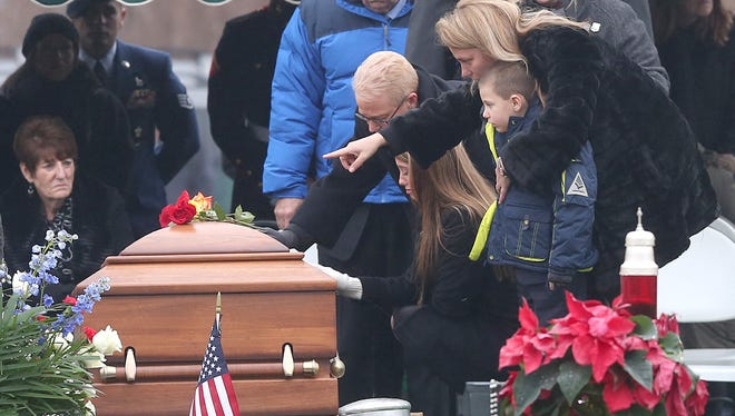 The family of Joseph Lemm, daughter Brooke, son Ryan and his wife Christine at his gravesite ceremony at Gate of Heaven cemetery in Hawthorne Dec. 30, 2015.