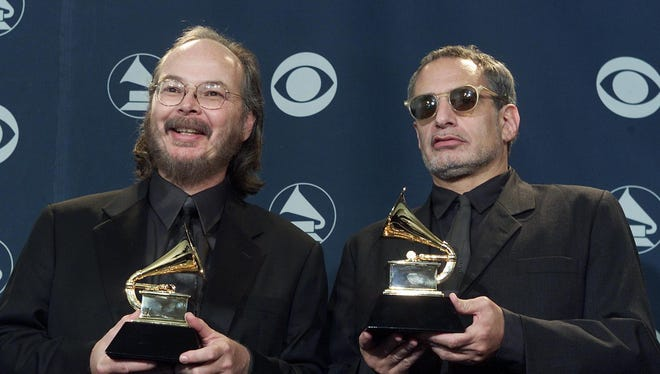 In February 2001,  Walter Becker, left and Donald Fagen of Steely Dan pose with their Grammy Awards for best pop vocal album at the 43rd Annual Grammy Awards in Los Angeles.