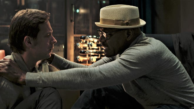 James D'Arcy and Delroy Lindo try to make their way through a ravaged near-future.