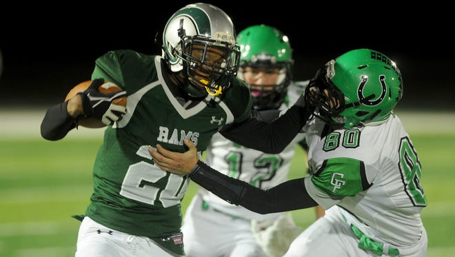 "Madison's Juwan Howard fights off the tackle of Clear Fork's Nate Hosey in a game last season. Howard is already an all-star ""vet,"" having scored a touchdown in the big school state contest."