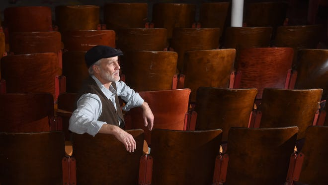 George Rowe, owner of Crash Music, has a seat inside the vacant Aztec Theater on Jan. 2 in Aztec.