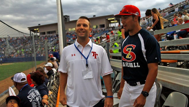 Farmington natives Griffin Phelps, left, and Damion Lovato talk on Tuesday at Ricketts Park in Farmington during the Connie Mack World Series. Both took part in the event as players and are now coaching teams in the tournament.