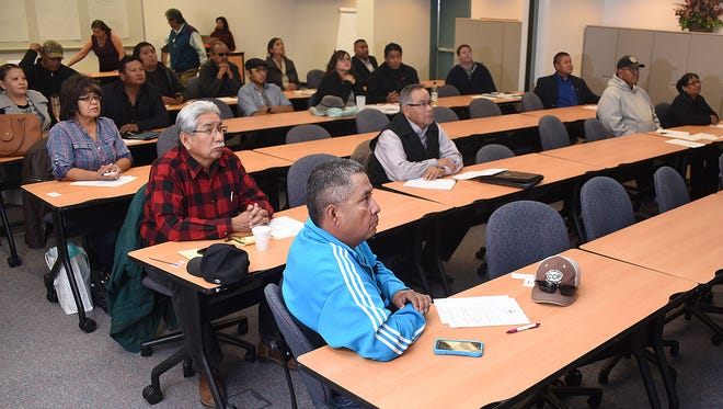 Aztec resident Leroy Nelson, front, attends a meeting on Saturday organized by the Dineh Chamber of Commerce at the San Juan College Quality Center for Business.