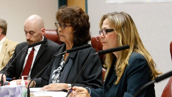 New Mexico Public Regulation Commissioner Lynda Lovejoy, center, and Valerie Espinoza, right, listen to complaints from AV Water Co. customers on, Oct. 12 at the San Juan County Administration Building in Aztec.
