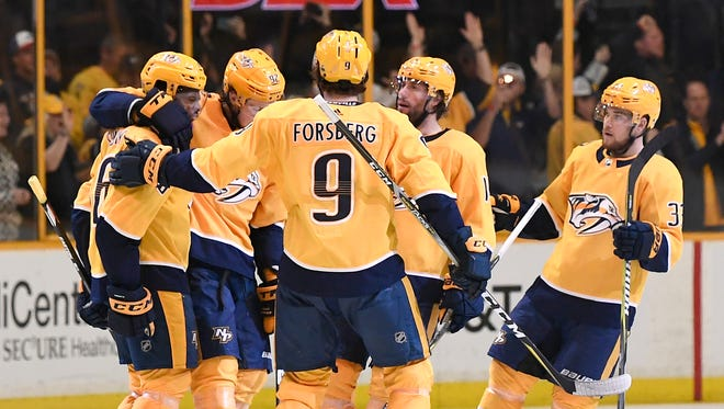 Predators players celebrate a goal by defenseman P.K. Subban (76) during Game 2 of their second-round playoff series in April.