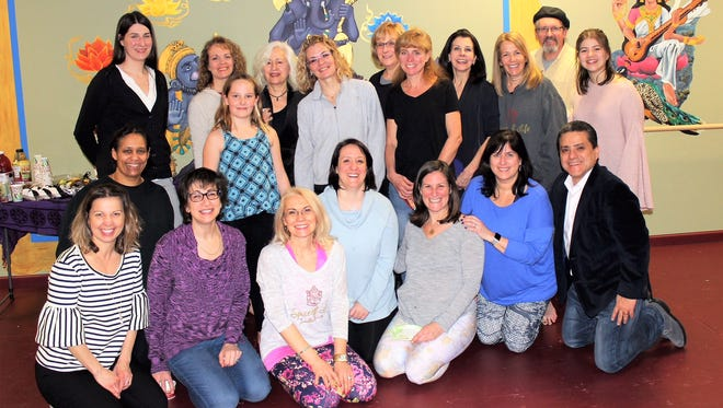 Spice of Life Yoga Studio in Flemington recently celebrated its third anniversary. Shown at the anniversary celebration are (first row, from left) Cande Arrieta, Jaimee Hawkins, Sara Bruinooge, Carla Tabussi, Meredith Milchanoski, Kerri Nehlsen and Gio Zamora; (middle row, from left) Val Hoskins, Theodora Milchanoski, studio owner Martha Hernandez and Rachel Lartiz; and (back row, from left) Lindsay Cherneski, Christine Romeo, Susan Tiscornia, Ann DeMarco, Cecile Sabatino, Debbie Meccia, John Kuhtik and Natalia Zamora.