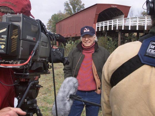 "Author Robert James Waller was in Madison County in October 2002 to tape a segment for the Travel Channel about visiting places that have a connection to movies. The local production crew taped Waller at the Roseman Bridge and in the town of Winterset, locations from the movie ""The Bridges of Madison County."""