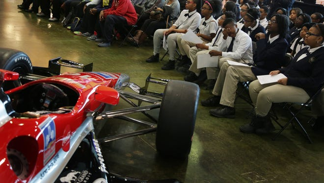 Students from Detroit King High School and University Prep Science & Math Middle School listen to defending Belle Isle IMSA WeatherTech SportsCar Championship winners Eric Curran and Dane Cameron speak at the Michigan Science Center in Detroit on Feb. 23, 2016.