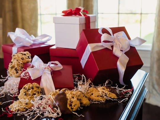 These are some of the gift boxes that Carney's Cookies come in. The online mail order gourmet cookie company was started by a Cinnaminson woman with the assistance of her fiance' and his family. The cookies are prepared and packaged at Carney's, a restaurant and bar in Cape May, which is her fiancee's family business.