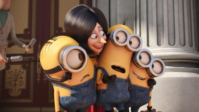 "In this image released by Universal Pictures, Scarlet Overkill, voiced by Sandra Bullock, second left, appears with minions Stuart, left, Kevin and Bob, right, in a scene from the animated feature, ""Minions."""