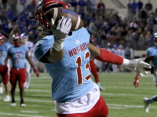 Hirschi's Javen Banks intercepts Decatur's Wilson Hicks in the endzone but a penalty gives the ball back to the Eagles Friday, Dec. 1, 2017, at Collins Athletic Complex in Denton.