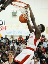 North Caddo's Chris Thomas gets the ball in the basket