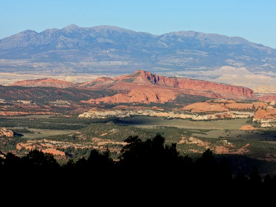 The red rock landscapes of Capitol Reef National Park are often visible from state Route 12 as it travels over Boulder Mountain.