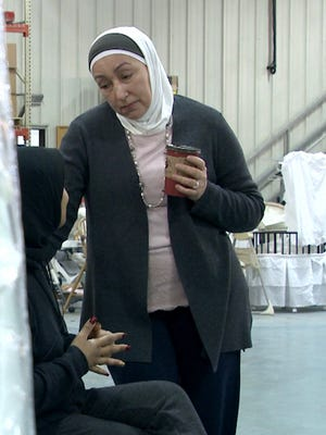 Najah Bazzy, founder of the non profit, Zaman International, shown Feb. 2, 2016, at her Inkster warehouse with a young woman without a home in need of assistance.