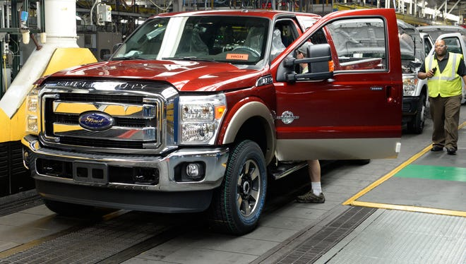 A diesel-power Ford F-series Super Duty nears the final stop on the assembly line at Ford's Kentucky Truck Plant in Louisville. Ford is adding 350 jobs to boost output.