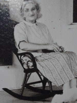 A picture of the author on the porch of the historic Florida Cracker house she and husband Schuyler B. Jackson called home.