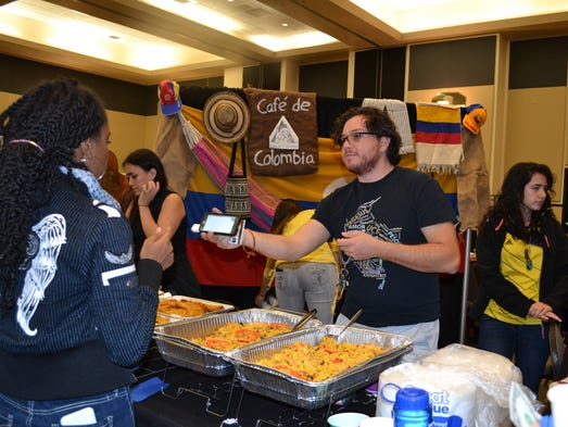The Colombian Student Association hands out food.