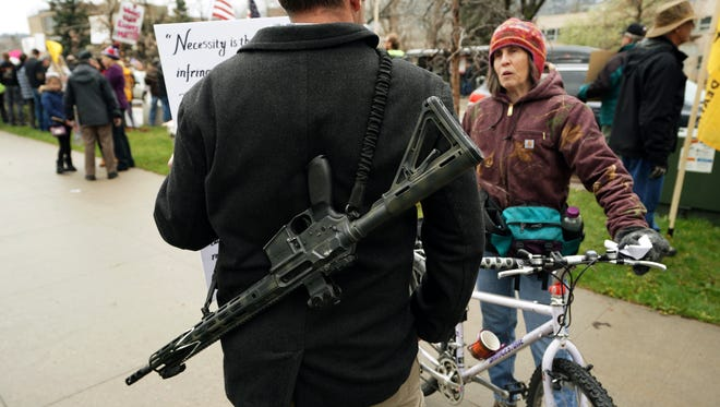A man openly carries his rifle at a pro-gun rally on April 21, 2018, in Boulder, Colo.