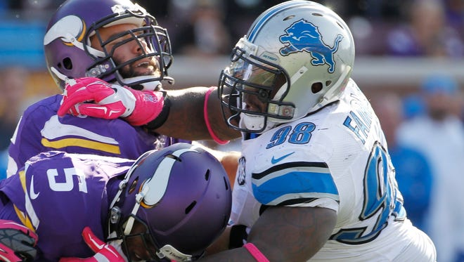 Minnesota Vikings quarterback Teddy Bridgewater (5) is tackled by Detroit Lions defensive tackle Nick Fairley (98) during the second half of an NFL football game Sunday, Oct. 12, 2014, in Minneapolis.