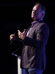 Denny Grimes, of Denny Grimes and Company, leads a real estate presentation on Tuesday during The News-Press Market Watch event at Germain Arena in Estero. Grimes was one of three real estate experts sharing insight on the Southwest Florida market.