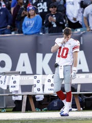 New York Giants quarterback Eli Manning (10) stands on the sideline during the second half of an NFL football game against the Oakland Raiders in Oakland, Calif., Sunday, Dec. 3, 2017. (AP Photo/Marcio Jose Sanchez)