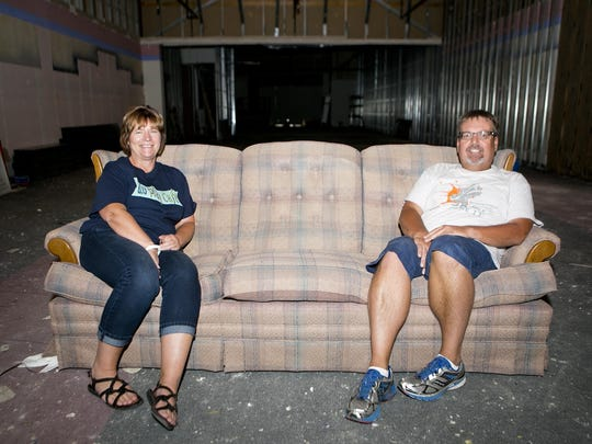 Owners Paula L Cammarata, left, sits on a couch with