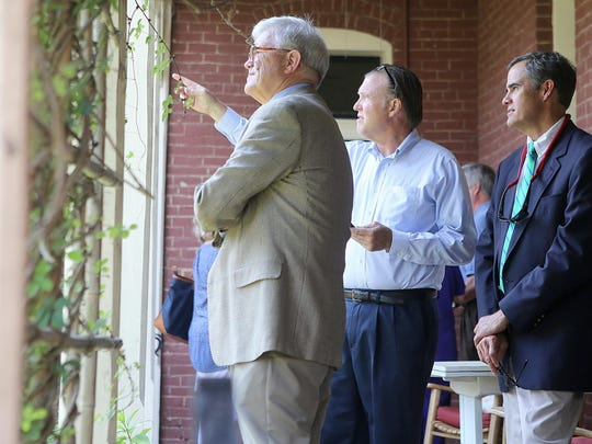 Standing outside The Cumberland House Aug. 28, Rex Leatherwood, center, U.S. Magistrate Judge Ed Bryant, left, and Tom Butler look over the grounds.