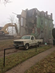 Provided photo of the house being demolished on the