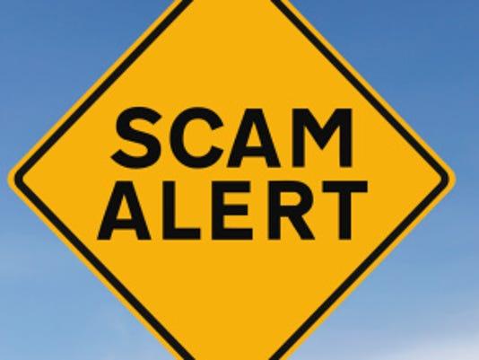 636112563599427952-scam.jpg