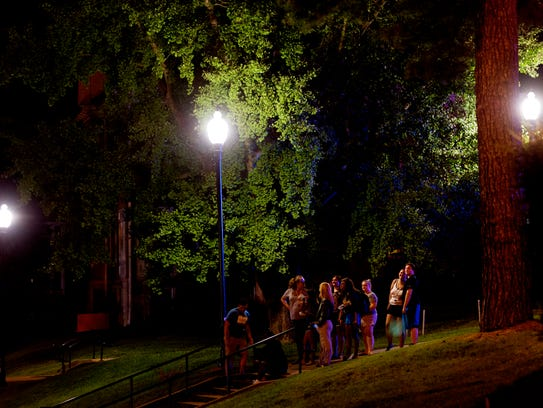Students wait outside as firefighters respond to a