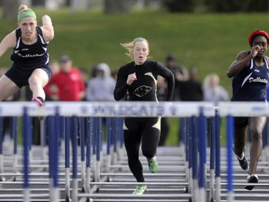 Red Lion's Cassidy Barshinger, center, and Dallastown's Tatiana Purnell, right, won't have to chase Dallastown's Sally Trout, left, this season in the 100-meter hurdles. (DAILY RECORD/SUNDAY NEWS -- FILE)