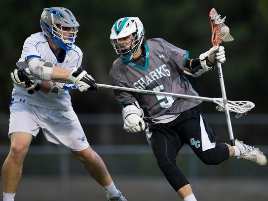 Barron Collier and Gulf Coast boy's lacrosse faceoff