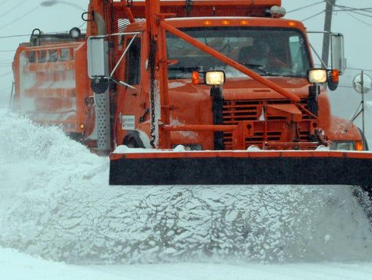 An Iowa DOT snowplow truck in operation in the Des