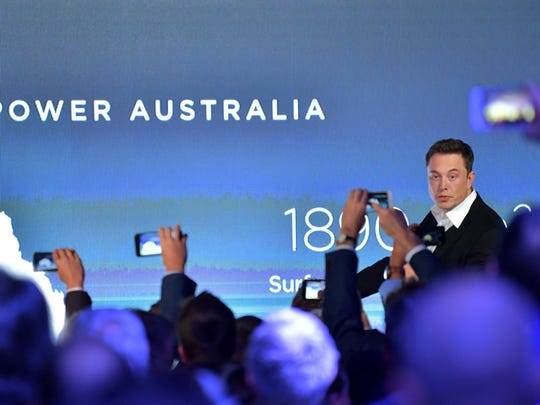 SpaceX chief Elon Musk gestures as he delivers a speech at the International Astronautical Congress in  Australia on Friday. Musk's elaborate plan for a mega-rocket to carry astronauts to Mars may have some down-to-Earth applications.