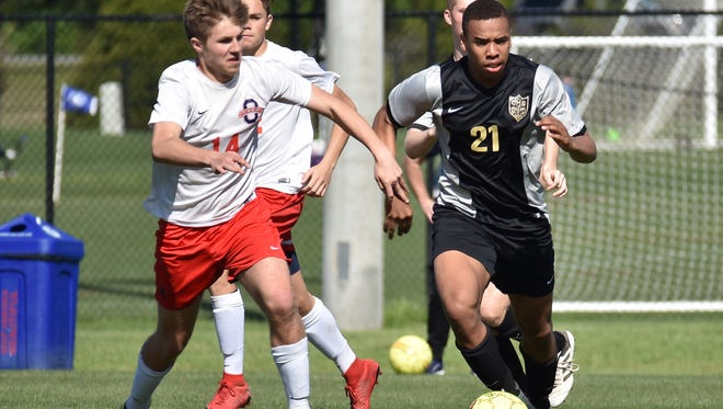 Central Magnet's Nick Hamlett (right) battles for a loose ball during a recent match. Hamlett is a nominee for area boys athlete of the week for April 30-May 6.