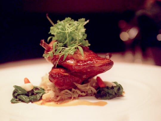 Pan seared breast of squab with sweet and sour cabbage