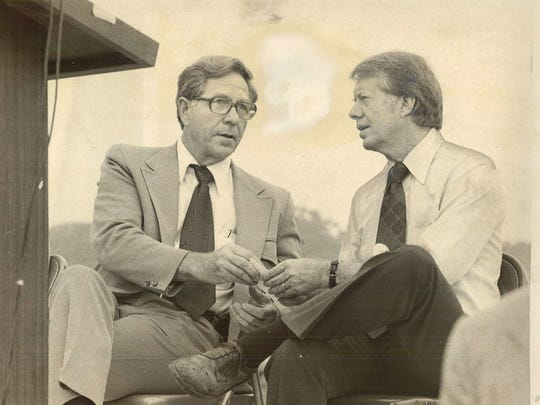 U.S. Rep. Neal Smith of Altoona chats with Democratic presidential candidate Jimmy Carter during a reception at the Don Van Ryswyk farm south of Des Moines on Aug. 25, 1976.